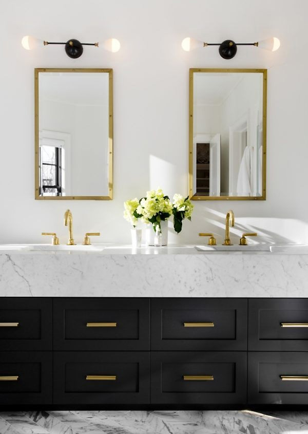 Brass sconces create a bold and modern look in a bathroom, especially against the usual clean colors of a bathroom such as blues, grays and whites.